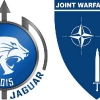 I loghi dell'Ex Trident Jaguar 15 e del Joint Warfare Centre (JWC)